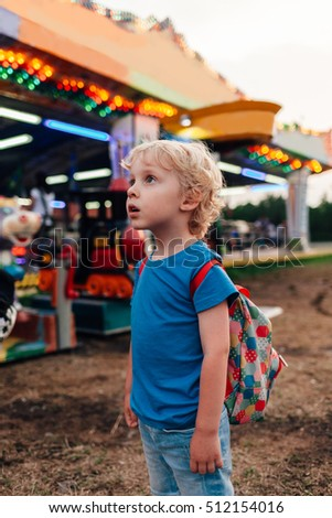 Enthusiastic boy looking at luna park