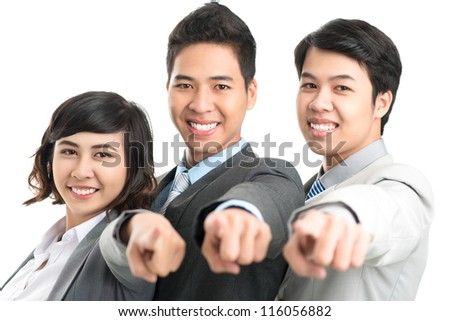 Enthusiastic business team choosing the viewer as their leader