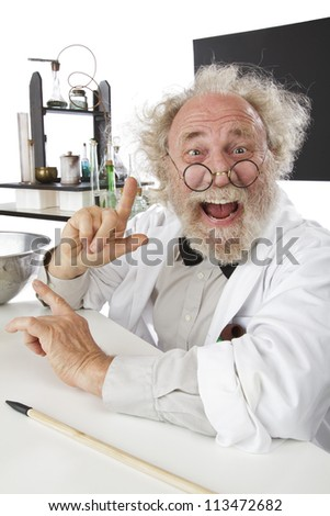 Enthusiastic eccentric senior scientist in his lab, pointing up and excited about his ideas. High key, vertical, copy space. - stock photo