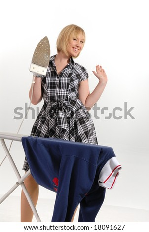 enthusiastic housewife with steam iron, pressing clothes - stock photo