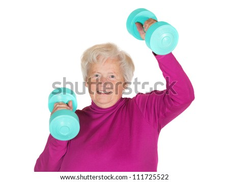 Enthusiastic senior lady working out with weights to maintain her vitality and zest for life in her retirement - stock photo