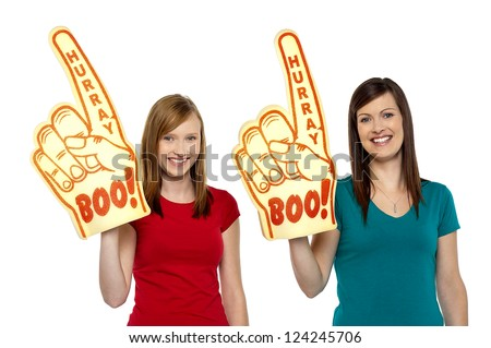 Enthusiastic supporters of the home team, cheering on white background. - stock photo