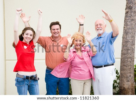 Enthusiastic voters proudly wearing their I Voted stickers.  (stickers are generic, not trademarked) - stock photo