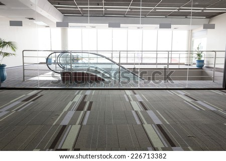 entrance  and escalator  - stock photo