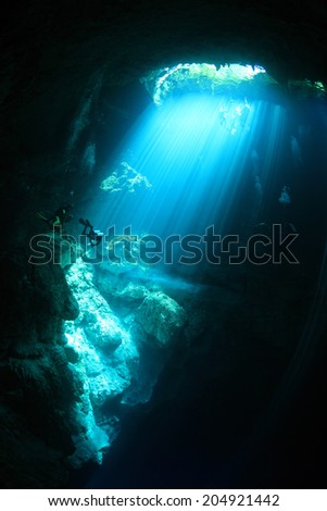 Entrance area of cenote underwater cave with sunlight  - stock photo