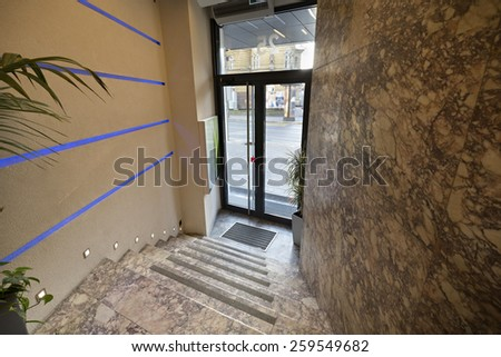 Entrance area to a small hotel - stock photo