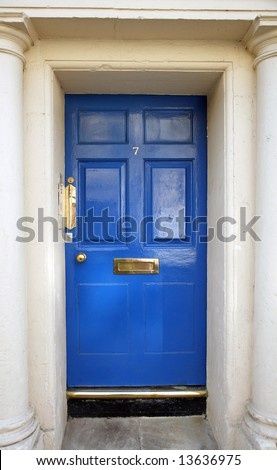 entrance door in an ancient house with columns, blue color - stock photo
