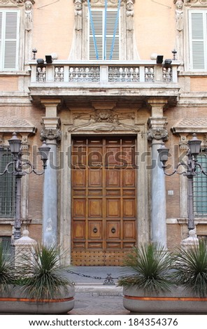 Entrance door of Madama Palace, houses of the Senate of the Italian Republic. Rome, Italy