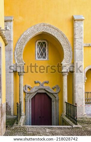 Entrance door of Pena National Palace in Sintra (Palacio Nacional da Pena), Portugal. - stock photo