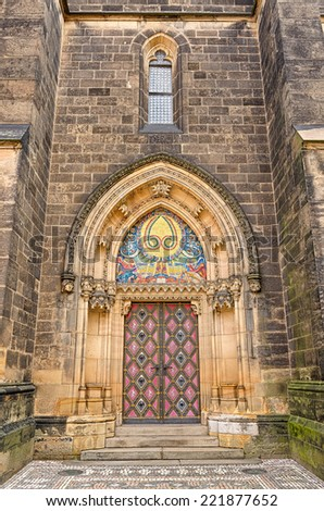 Entrance door of the neo-Gothic Saint Peter and Paul Cathedral in Vysehrad fortress, Prague.  In 2003 the church was elevated to basilica by Pope John Paul II. - stock photo