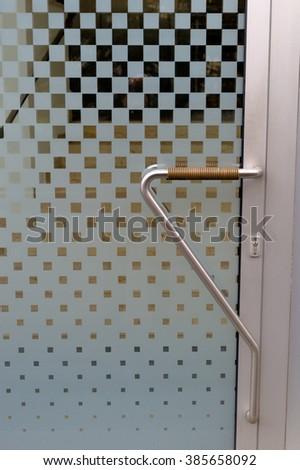 entrance door with doorbell and intercom - stock photo