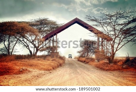 Entrance gate by the border of the famous serengeti national park   - stock photo
