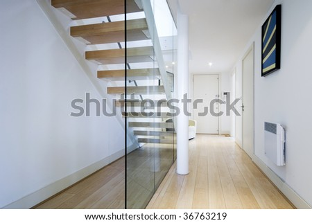entrance hall with staircase and glass wall - stock photo