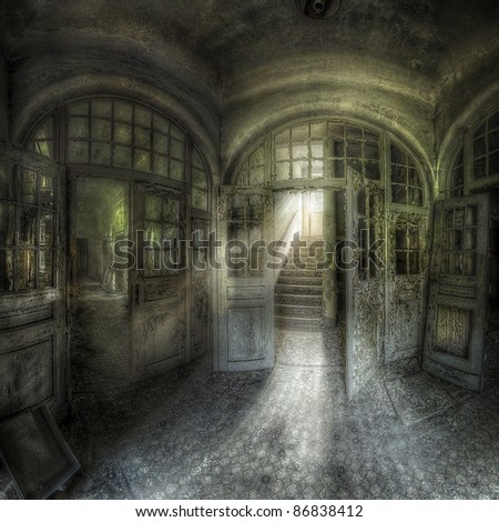 entrance hall with worn out doors of an abandoned complex, hdr processing - stock photo