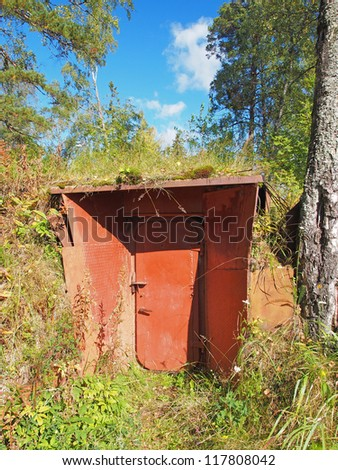 Entrance in an air-raid shelter underground in the forest. Russia. Karelia.