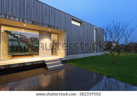 Entrance of a beautiful modern house, night scene - stock photo