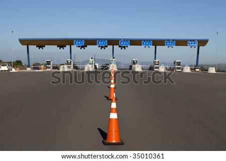 Entrance of a highway toll checkpoint - stock photo