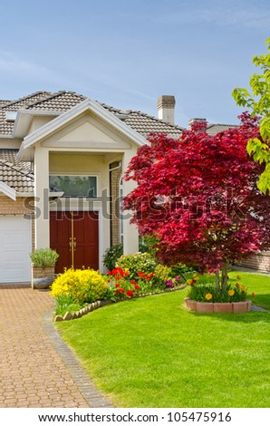 Entrance of a house with a nice red tree in Vancouver, Canada. - stock photo