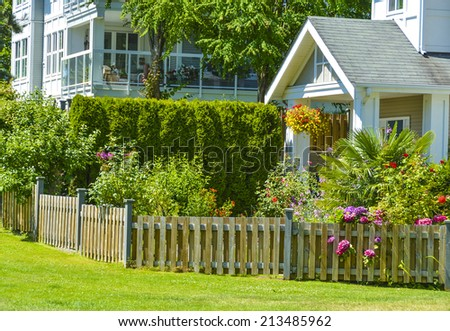 Entrance of apartment building on sunny day. Residential apartment building in Vancouver, British Columbia. - stock photo