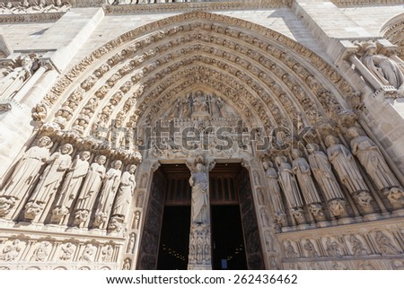 Entrance of Notre Dame with lots of relief sculptures in Paris, France - stock photo