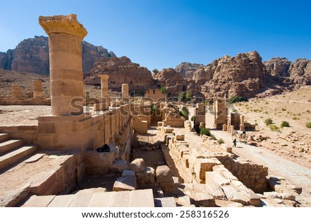 Entrance of the Great Temple at colonnaded street in Petra in Jordan - stock photo