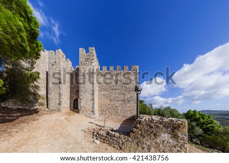 Entrance of the medieval Sesimbra castle, Portugal. - stock photo