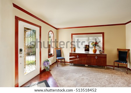 Entrance Room With Comfortable Sitting Area Large Console Table Two Chairs Arched Window