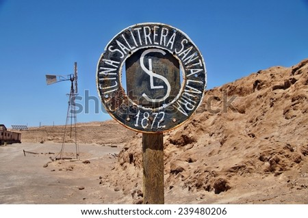 Entrance sign of deserted ghost town of Santa Laura near Iquique, Chile - stock photo