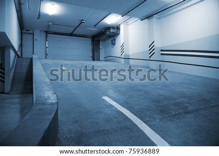 Entrance to a modern underground car park - stock photo
