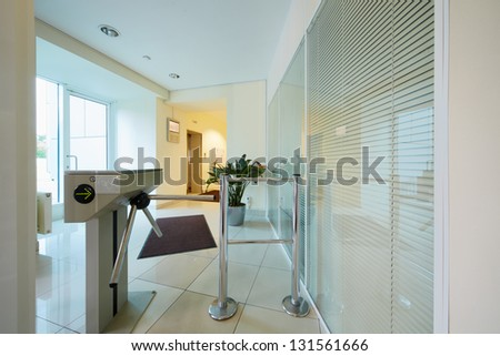 Entrance to administrative building equipped with automatic turnstile - stock photo