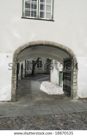 Entrance to an old courtyard in Tallin Estonia - stock photo