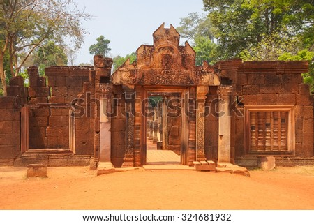 Entrance to Banteay Srei temple in the ruins of Khmer city of Angkor, Cambodia - stock photo