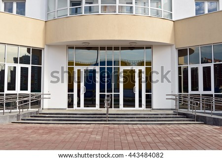 entrance to building with glass doors - stock photo