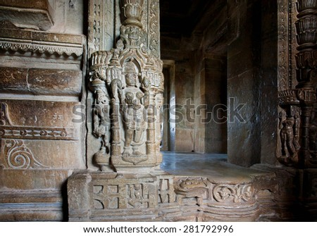 Entrance to hindu temple with carving wall in India - stock photo
