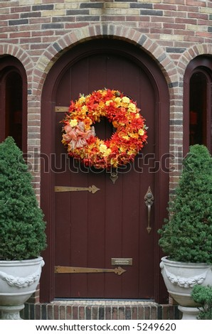 entrance to home with orange wreath - stock photo
