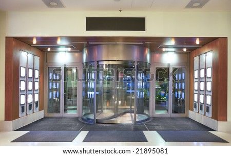 Entrance to hotel lobby with revolving door. - stock photo