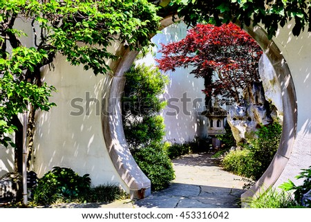 Entrance to Japanese Gardens with trees and bushes - stock photo