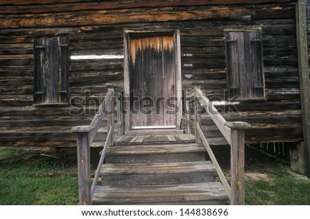 Entrance to log cabin in historic Camden, SC - stock photo