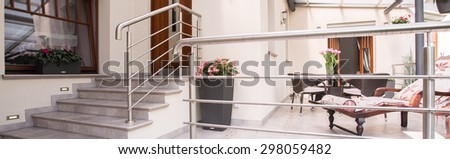 Entrance to luxury house with cozy terrace - stock photo