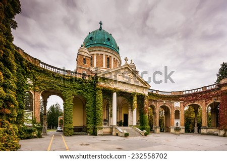 Entrance to Mirogoj cemetery with Church of King Christ in Zagreb, Croatia during the fall - stock photo