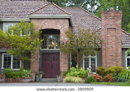 Entrance to Northwest style luxury home - stock photo