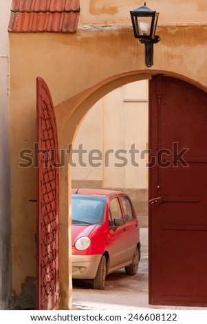 Entrance to old yard in historic part of Lviv, Ukraine - stock photo