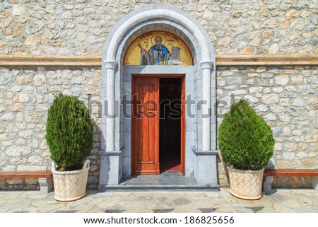 Entrance to the church in Pothia, Greece - stock photo