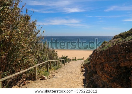 entrance to the empty beach in Sagres, Algarve, Portugal - stock photo