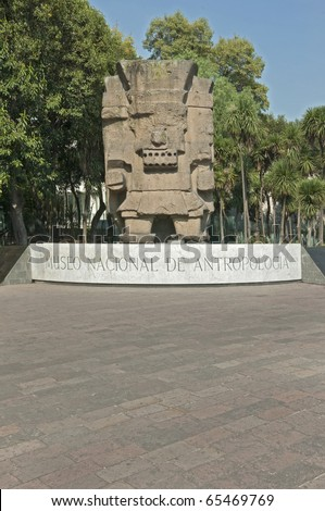 Entrance to The National Museum of Anthropology in Mexico City Colossal stone sculpture representing Tlaloc, a very important deity of Aztec culture (God of Rain). - stock photo
