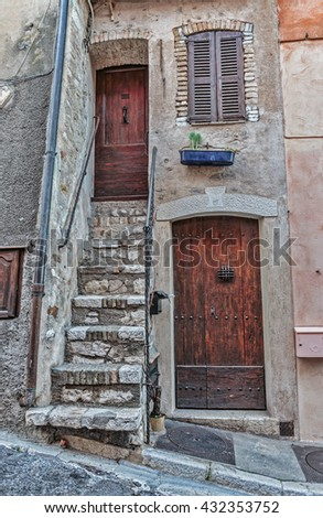 Entrance to the old French house - stock photo