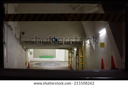 Entrance to underground car parking at night time - stock photo