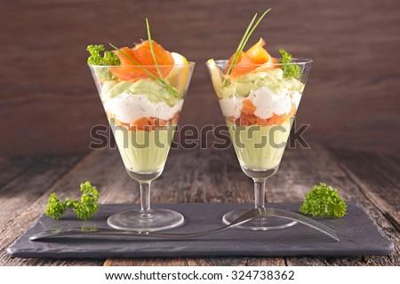entree, avocado mousse with cream and smoked salmon - stock photo