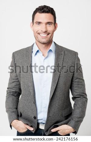 Entrepreneur standing with his hands in pockets - stock photo