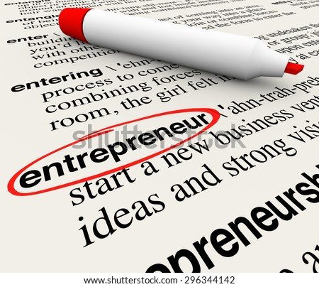 Entrepreneur word circled with dictionary definition to illustrate or define a business person starting a new innovative company